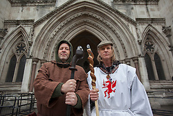 © licensed to London News Pictures. London, UK 15/05/2013. Druids of The Loyal Arthurian Warband posing outside the Royal Courts of Justice in London on Wednesday, 15 May 2013. Druids demand that ancient human remains found around Stonehenge should be returned to where they were found after the scientific researches, against the plans of English Heritage to store them for future generations to study. Photo credit: Tolga Akmen/LNP