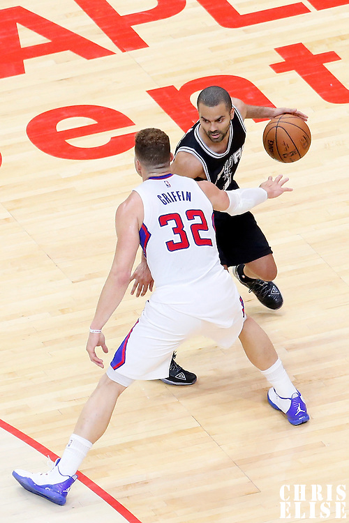 19 April 2014: San Antonio Spurs guard Tony Parker (9) drives past Los Angeles Clippers forward Blake Griffin (32) during the Los Angeles Clippers 107-92 victory over the San Antonio Spurs, during Game One of the Western Conference Quarterfinals of the NBA Playoffs, at the Staples Center, Los Angeles, California, USA.