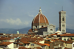 Florence, Italy:  The Dome and Campanile of the Duomo dominate the skyline of this red-roofed city.  The dome is by Brunelleschi (1463), the largest ever built without scaffolding.