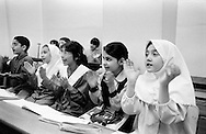 Iranian girls and boys clapping and singing the notes during a music lesson. Sexes mix in private classes, although in the regular schools the sexes rarely mix. Tehran, Iran, 2007