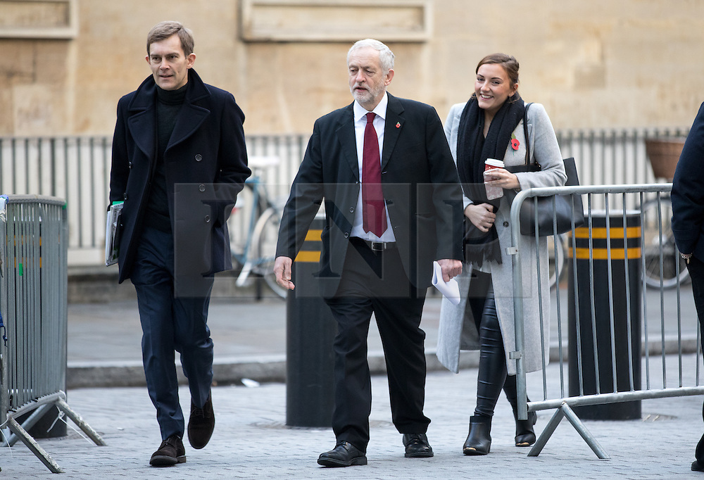 © Licensed to London News Pictures. 13/11/2016. London, UK. Leader of the Labour Party Jeremy Corbyn MP (R) and Seumas Milne, Head of Strategy and Communications arrive at the Andrew Marr Show today. The show has been heavily criticised for screening a pre-recorded interview with far-right politician Marine Le Pen, who associates with Le Front National (The National Front). Photo credit : Tom Nicholson/LNP
