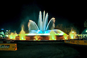 The illuminated Font Magica or Magic Fountain in front of the National Art Museum of Catalonia, Barcelona, Spain