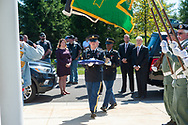 An honor guard arrives with an American flag and the last remains to be buried during burial services with full military honors, held for 12 veterans left unattended by family or friends Thursday, August 29, 2019 at Washington Crossing National Cemetery in Washington Crossing, Pennsylvania. Standing to the left is Rep. Brian Fitzpatrick. Once a month, burials are held for veterans who have no family and their remains have never been claimed. Some vets remains have waited 12 years for burial. Justine was instrumental in the burial of 9 veterans from Chester County.  (Photo by William Thomas Cain / CAIN IMAGES)