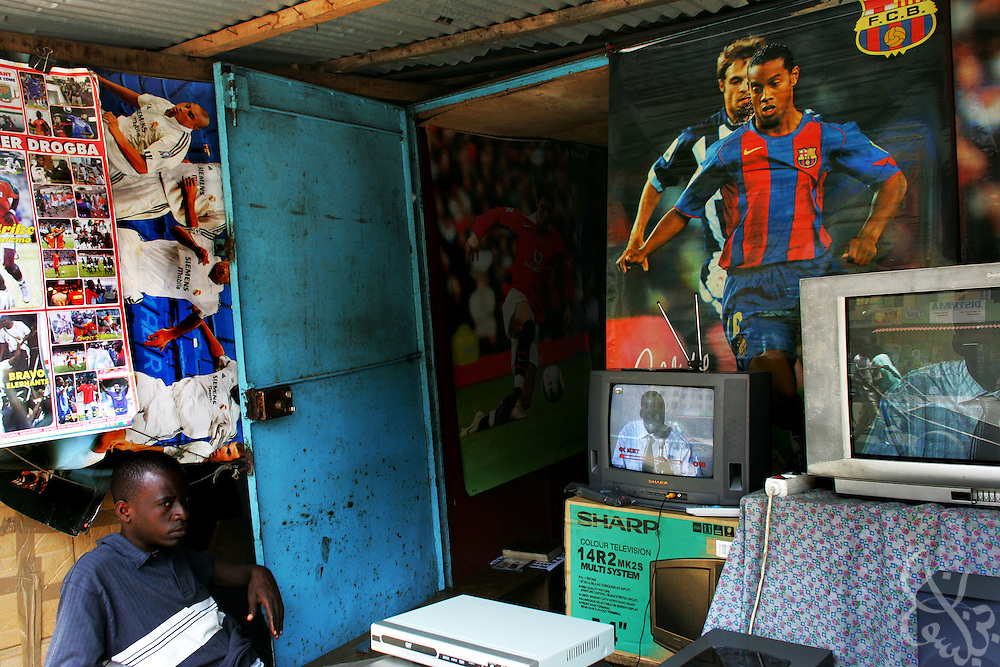 An Ivorian vendor uses images of football to entice buyers of televisions in the Port Bouet neighborhood of Abidjan, Ivory Coast February 17,2006. Football is an integral part of the social fabric that makes up Ivorian society.