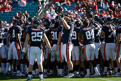 Virginia defensive end Chris Long (91) lifts his helmet as teammates gather before the start of the Gator Bowl.  The Texas Tech Red Raiders defeated the Virginia Cavaliers 31-28 in the 2008 Konica Menolta Gator Bowl held at the Jacksonville Municipal Stadium in Jacksonville, FL on January 1, 2008.