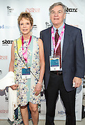 Paige Royer and guest on the red carpet during opening night of the 25th Anniversary New Orleans Film Festival; Opening night film is 'Black and White' directed by Mike Binder