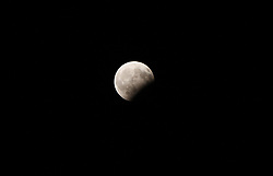 August 7, 2017 - Varna, Sofia, Bulgaria - A partal moon eclipse is seen in the night sky over the Black sea town of Varna, east of the Bulgarian capital Sofia, Monday, August, 07, 2017. (Credit Image: © Impactpressgroup.Org/NurPhoto via ZUMA Press)