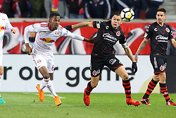 March 13, 2018 - Harrison, NJ, U.S. - HARRISON, NJ - MARCH 13:  Tijuana defender Pablo Aguilar (12) battles New York Red Bulls defender Michael Murillo (62) during the second half of the CONCACAF Champions League Quarter-final match between the New York Red Bulls and Club Tijuana on March 13, 2018, at Red Bull Arena in Harrison, NJ.  (Photo by Rich Graessle/Icon Sportswire) (Credit Image: © Rich Graessle/Icon SMI via ZUMA Press)