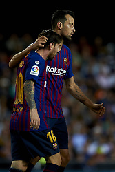 October 7, 2018 - Valencia, Valencia, Spain - Lionel Messi celebrates goal with teammates Sergio Busquets during the week 8 of La Liga match between Valencia CF and FC Barcelona at Mestalla Stadium in Valencia, Spain on October 7, 2018. (Credit Image: © Jose Breton/NurPhoto/ZUMA Press)