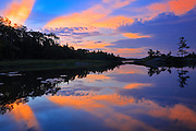 Clouds reflected in Middle Lake at dawn<br /> Kenora<br /> Ontario<br /> Canada