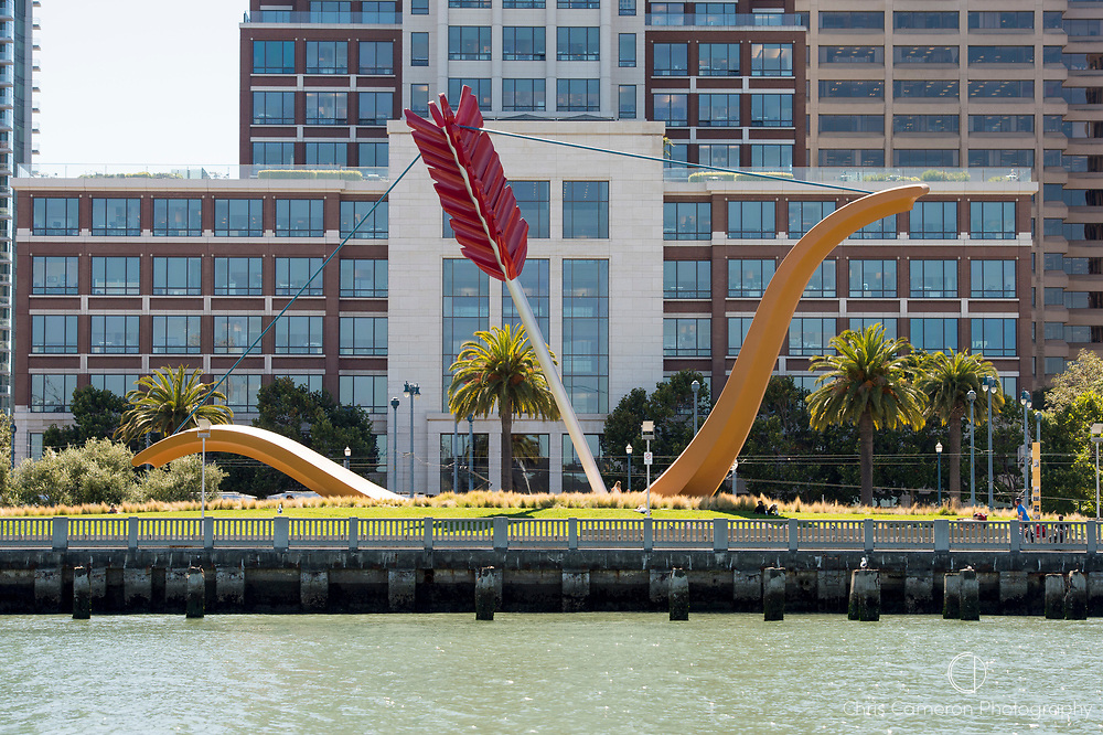 Bow and arrow sculpture by artists Claes Oldenburg and Coosje van Bruggen, titled Cupid's Span at Rincon Park on the Embarcadero, San Francisco, California, USA
