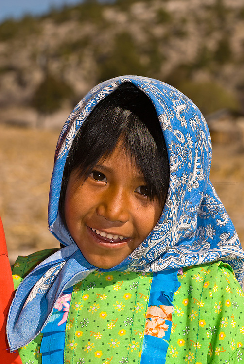Tarahumara Indian girl wearing colorful native costume, Ejido San Alonso, Copper Canyon (near San Rafael), Mexico