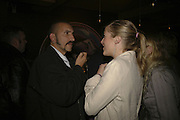 Paul Crowder and Kate Rogers, Drinks at OQO, Islington Green  after  screening of ' Once In a Lifetime-Thje extraordinary Story of the New York Cosmos at the Screen On the Green, Islington. London. 15 May 2006. ONE TIME USE ONLY - DO NOT ARCHIVE  © Copyright Photograph by Dafydd Jones 66 Stockwell Park Rd. London SW9 0DA Tel 020 7733 0108 www.dafjones.com