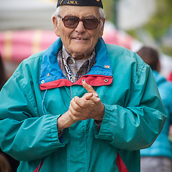 A veteran walking down High Street in Worthington on the opening day of the farmer's market Saturday May 3, 2014. (Christina Paolucci, photographer).