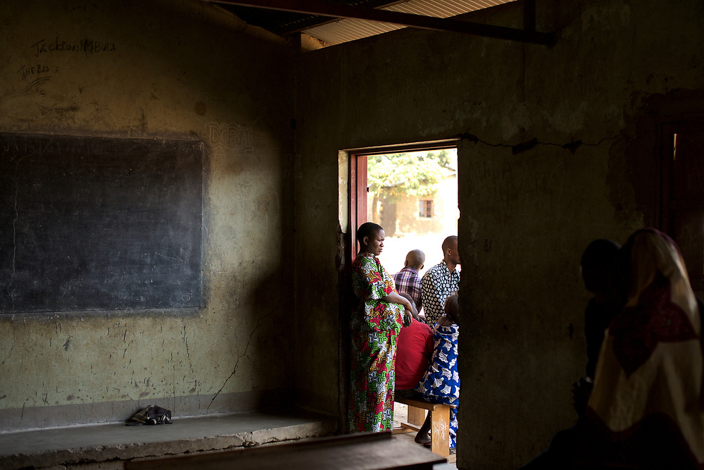 Members of Burundiís National Electoral Commission stand outside a classroom used as a poling station for the parliamentary elections in Cibitoke neighbourhood, Bujumbura, June 28th, 2015.