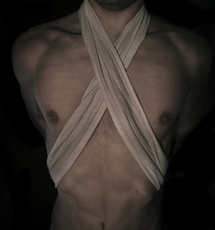 A male figure with a bandage across their chest