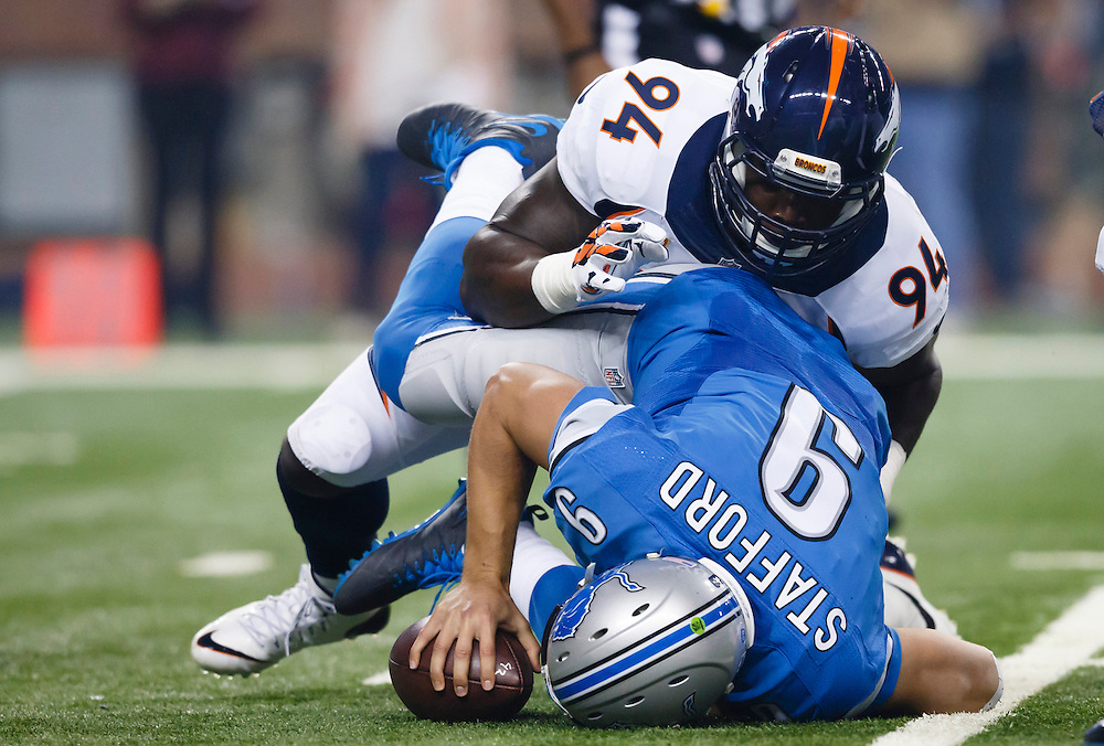 Detroit Lions quarterback Matthew Stafford is sacked by Denver Broncos outside linebacker DeMarcus Ware (94) during the first half of an NFL football game at Ford Field in Detroit, Sunday, Sept. 27, 2015. (AP Photo/Rick Osentoski)