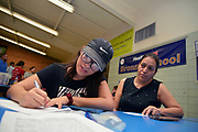 "Volunteers from Keep Tucson Together and attorney Margo Cowan provide legal assistance to persons effected by changes to DACA, or Deferred Action Childhood Arrival, which provided legal protection to those brought into the United States illegally as children, at a clinic at Pueblo Magnet High School, Tucson, Arizona, USA. ""Edna"", 21, entered the USA on a legal visa at the age of 9, along with her family.  Her father intended to sat in the USA to work. Her family chose to overstay their visas to avoid prolonged separation from her father.  She applied for and was granted DACA status, which lapsed in August, 2017.  With changes to DACA, she faces possible deportation if stopped by law enforcement.  She is a nursing student under the protection of DACA, but may lose that right, as she lost her job when she lost her DACA status.  She is now unemployed.  She initially arrived in the USA with her parents and two siblings.  Her parents then had two US born children.  She attends the clinic to be prepared with legal advice should she be stopped by law enforcement and be slated for deportation to Mexico."