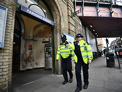 © Licensed to London News Pictures. 16/09/2017. London, UK. Police patrol around Parsons Green station in London the day after a bomb partly exploded on a tube train at Parsons Green station in London injuring members of the public. Operation temperer has been put in to place after the UK terror threat level was raised to critical. Photo credit: Ben Cawthra/LNP