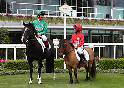 Frankie Dettori and his son Rocco in the parade ring during a media day at Ascot Racecourse, Esher.
