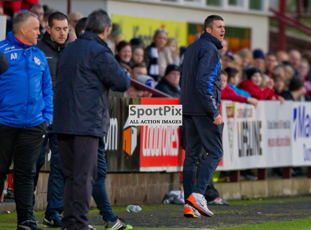 Dunfermline Athletic v Cowdenbeath SPFL League One Season 2015/16 East End Park 02 January 2016<br />  <br /> Colin Nish is sent to the stand for encroaching on the pitch<br /> <br /> Dunfermline Athletic take on Cowdenbeath in League one, but also comemorate 20 years since the passing of DAFC player Norrie McCathie. Dunfermline and Cowdenbeath were the only two teams McCathie signed for and Dunfermline wear a replica of the strip Norrie last wore against St Mirren at Love Street in 1995. Cowdenbeath also wear a one off strip to comemorate the towns coal mining history. <br /> <br /> CRAIG BROWN | sportPix.org.uk