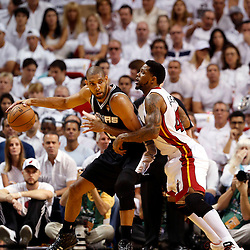 Jun 9, 2013; Miami, FL, USA;  San Antonio Spurs power forward Tim Duncan (21) drives against Miami Heat power forward Udonis Haslem (40) during the first quarter of game two of the 2013 NBA Finals at the American Airlines Arena. Mandatory Credit: Derick E. Hingle-USA TODAY Sports