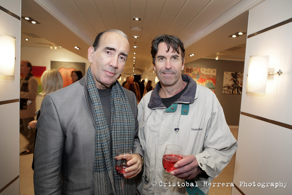 From left, Luis Casas and Mike Tran, attend the MIA Art Fair aboard SeaFair on the Preview day on January 16, 2014.