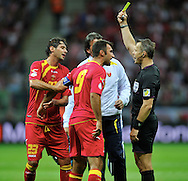 Montenegro's Mirko Vucinic is shown a yellow card during the FIFA World Cup 2014 group H qualifying football match of Poland vs Montenegro on September 6, 2013 in Warsaw, <br />