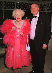 DAME BARBARA CARTLAND and her son MR IAN McQUORQUODALE at a party in London on 23rd March 1998.MGH 56