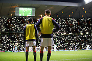Dundee substitutes Faissal El Bakhtaoui and Jesse Curran watch the match as Celtic fans light up the stadium with mobile phones in the 67th minute of the match in a tribute to the 50th anniversary season of the club's European Cup win - Celtic v Dundee in the Ladbrokes Scottish Premiership at Celtic Park, Glasgow. Photo: David Young<br /> <br />  - © David Young - www.davidyoungphoto.co.uk - email: davidyoungphoto@gmail.com