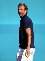 France's Julien Benneteau complains to the referee about the crowd noise during day four of the Fever-Tree Championship at the Queen's Club, London.