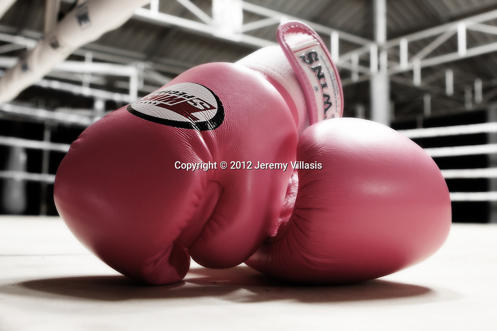 Pink boxing gloves, a fitting representation of Nong Toom. It is her favorite color as well. This is the photo of the introduction to my final Portfolio for the Konrad Adenauer Asian Center for Journalism at the Ateneo de Manila University's Diploma in Photojournalism program.