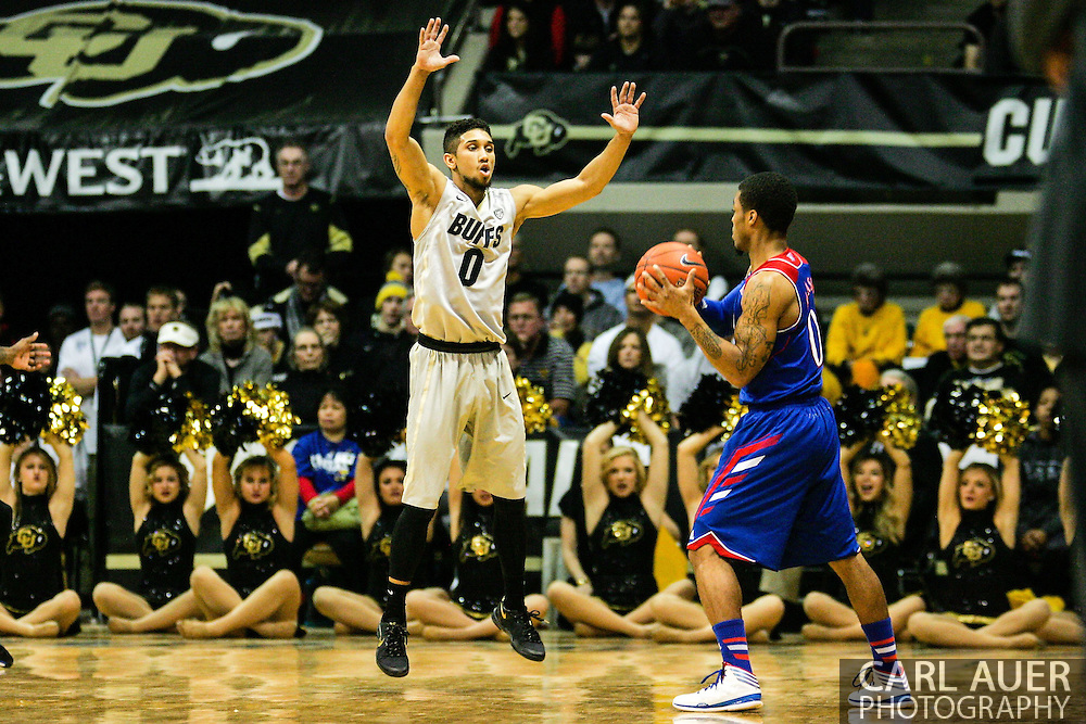 December 7th, 2013:  Colorado Buffaloes junior guard Askia Booker (0) defends Kansas Jayhawks freshman guard Frank Mason (0) in the first half of action in the NCAA Basketball game between the Kansas Jayhawks and the University of Colorado Buffaloes at the Coors Events Center in Boulder, Colorado