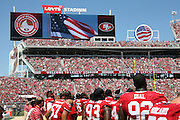 Players line up for the playing of the National Anthem as flags fly on the stadium scoreboards in this general view photo of the interior of Levi's Stadium taken from field level before the San Francisco 49ers 2014 NFL preseason football game against the San Diego Chargers on Sunday, Aug. 24, 2014 in Santa Clara, Calif. The 49ers won the game 21-7. ©Paul Anthony Spinelli