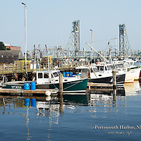 Portsmouth Harbor, NH.  Boats at the state docks. Memorial Bridge in the background.<br />