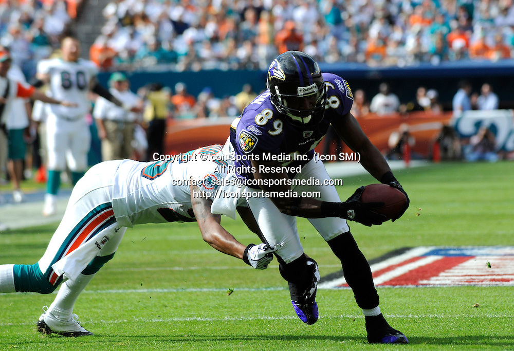 04 January 2009: Baltimore Ravens Wide Receiver Mark Clayton (89) runs with the ball and is tackled by Miami Dolphins Cornerback Will Allen (25) as the Baltimore Ravens defeated the Miami Dolphins 27-9 in an NFL AFC Wild Card Playoff game at Dolphin Stadium in Miami, Florida.