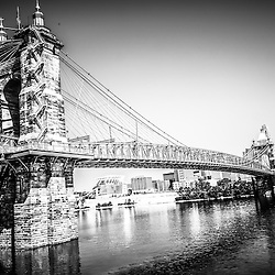 Cincinnati Roebling Bridge black and white photo. The John A. Roebling suspension bridge was built in 1865 and crosses the Ohio River connecting Covington Kentucky with Cincinnati Ohio. The picture is high resoution and was taken in July 2012.