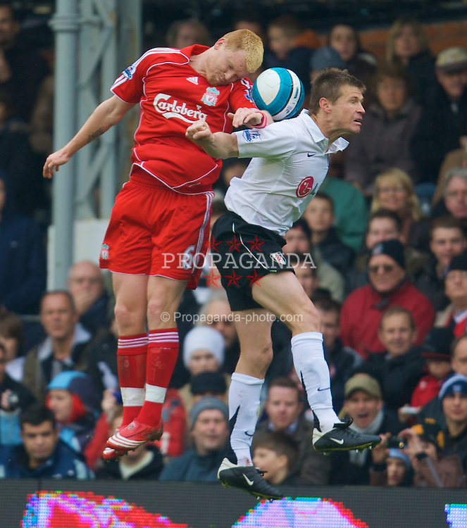 LONDON, ENGLAND - Saturday, April 19, 2008: Liverpool's John Arne Riise in action against Fulham's Brian McBride during the Premiership match at Craven Cottage. (Photo by David Rawcliffe/Propaganda)