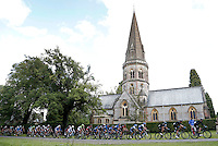 Sir Bradley Wiggins leads the peleton in the Prudential RideLondon-Surrey Classic as it passes St Barnabas Church, in Ranmore Common<br /> <br /> Prudential RideLondon, the world&rsquo;s greatest festival of cycling, involving 70,000+ cyclists &ndash; from Olympic champions to a free family fun ride - riding in five events over closed roads in London and Surrey over the weekend of 9th and 10th August. <br /> <br /> Photo: Jed Leicester for Prudential RideLondon<br /> <br /> See www.PrudentialRideLondon.co.uk for more.<br /> <br /> For further information: Penny Dain 07799 170433<br /> pennyd@ridelondon.co.uk