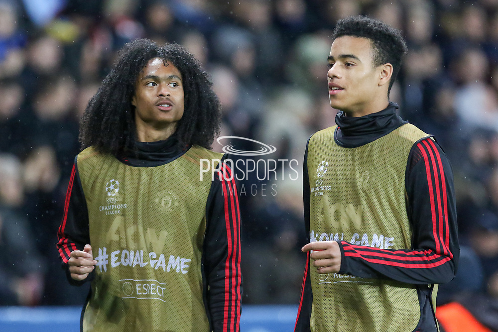 Manchester United Forward Tahith Chong and Manchester United forward Mason Greenwood warm up as substitutes during the Champions League Round of 16 2nd leg match between Paris Saint-Germain and Manchester United at Parc des Princes, Paris, France on 6 March 2019.