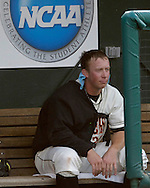 Oregon State starting pitcher Jonah Nickerson sits in the dugout between inning against North Carolina.  Oregon State defeated North Carolina 3-2 for the National Championship at the College World Series at Rosenblatt Stadium in Omaha, Nebraska, June 26, 2006.