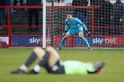 Joe Day of Wimbledon prepares to save as Mads Bech Sørensen of Wimbledon lies injured during the EFL Sky Bet League 1 match between Accrington Stanley and AFC Wimbledon at the Fraser Eagle Stadium, Accrington, England on 1 February 2020.