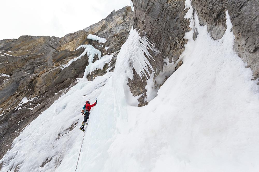 Zac Colbran climbing the first pitch of Kitty Hawk, WI5, near Nordegg, Alberta
