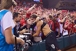 ST. LOUIS, USA - Monday, August 1, 2016: Liverpool's Lazar Markovic gives his shirt away to a supporter after a pre-season friendly game against AS Roma on day twelve of the club's USA Pre-season Tour at the Busch Stadium. (Pic by Concepcion Valadez/Propaganda)