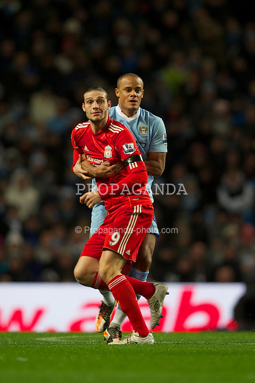 MANCHESTER, ENGLAND - Tuesday, January 3, 2012: Liverpool's Andy Carroll is held back by Manchester City's Vincent Kompany during the Premiership match at the City of Manchester Stadium. (Pic by David Rawcliffe/Propaganda)