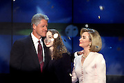 U.S President Bill Clinton hugs daughter Chelsea and wife Hillary Rodham Clinton as confetti falls after accepting the presidential nomination for the democrat party at the 1996 Democratic National Convention August 29, 1996 in Chicago, IL.
