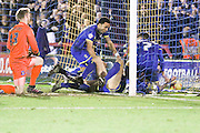 Paul Robinson of AFC Wimbledon subsequently puts in Lyle Taylor of AFC Wimbledon free kick during the Sky Bet League 2 match between AFC Wimbledon and Carlisle United at the Cherry Red Records Stadium, Kingston, England on 23 February 2016. Photo by Stuart Butcher.