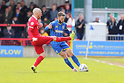 Sean Clohessy defender for Leyton Orient (2) attempts bloke Callum Kennedy defender for AFC Wimbledon (3) pass during the Sky Bet League 2 match between AFC Wimbledon and Leyton Orient at the Cherry Red Records Stadium, Kingston, England on 23 April 2016. Photo by Stuart Butcher.