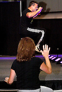 Peggy Mary of Union follows Zumba instructor Doug Jones of The Studio Fitness on the runway stage during the Dayton Women's Fair at the Airport Expo.Center in Vandalia., Saturday, September 17, 2011.