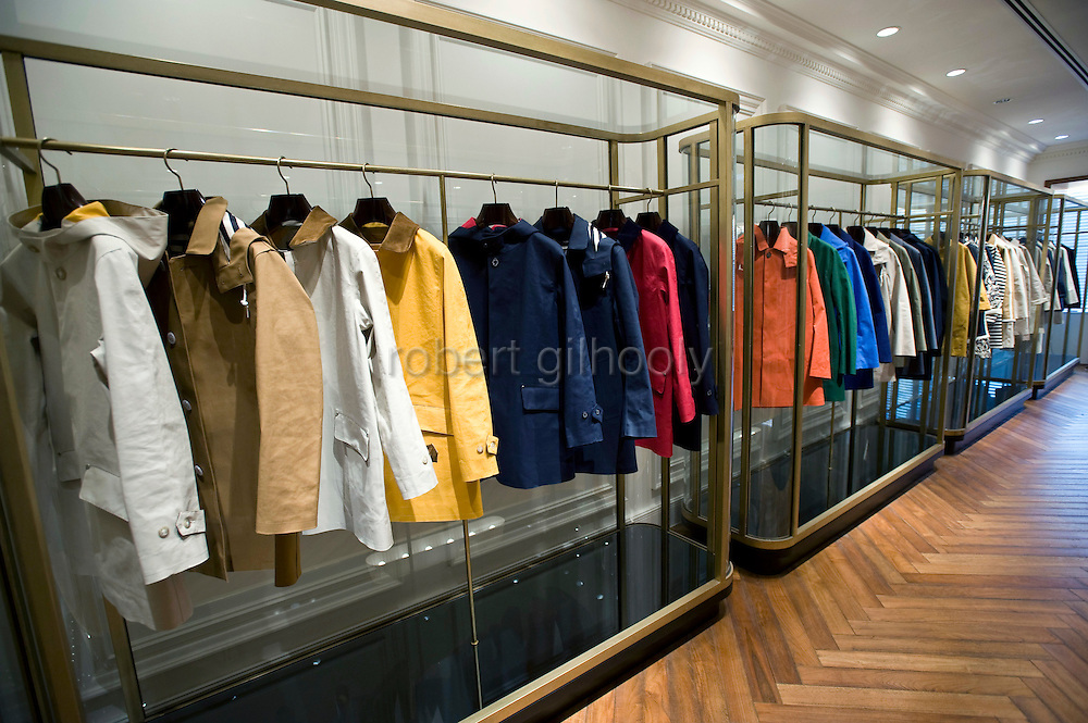 A display room shows Mackintonsh products at Yagi Tsusho Ltd. offices in Tokyo, Japan on 28 July, 2011. In June, company president Yuzo Yagi received an honorary OBE in recognition of his contribution to business relations between Japan and the UK. The company has enjoyed successful relationships with notable UK brands such as Mackintosh, Barbour and Alexander McQueen..Photographer: Robert Gilhooly